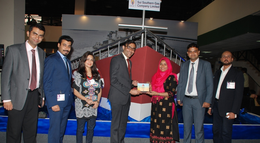 Uzair Ahmed Khan, on behalf of SSGC's Corporate Communication Department,  receiving the 'Best Corporate Booth' award from the representative of Pegasus at Pakistan Oil and Gas Energy Exhibition (POGEE), held from April 23-25, 2015.