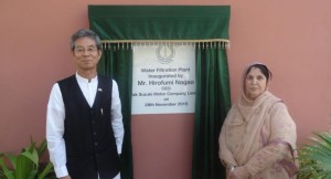 Hirofu mi Nagao, Managing Director, Pak Suzuki Motor inaugurate the Water Filter Plant of Hamdard University. Sadia Rashid, Chancellor Hamdard University is also seen in the picture.