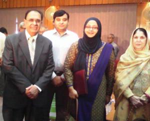 A group photograph shows Dr. Afsheen Khan, President, Shifaul Mulk Memorial Academy (Centre) alongwith Dr. Atta ur Rahman and Mrs. Sadia Rashid, Chancellor, Hamdard University. Dr. Salman Khan also standing behind.